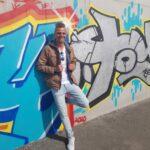 Profielfoto René tegen graffiti muur